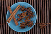 Cinnamon on Blue Plate — Stock Photo