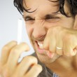 Handsome man angry with cigarette ready to punch it — Stock Photo