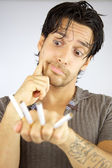 Man with cigarettes funny face — Stock Photo