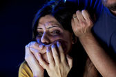 Woman with hand in front of her face not able to scream — Stock Photo