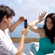 Couple playing while taking picture on a lake — Stock Photo