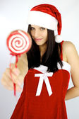 Beautiful woman santa claus with lollipop — Stock Photo