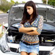 Beautiful woman sad with broken car in middle of street — Stockfoto