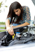 Woman checking car broken engine — Stock Photo