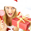 Stock Photo: Happy beautiful female santa claus with gift for christmas