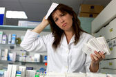 Funny pharmacist at work — Stock Photo