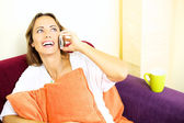 Beautiful woman talking on the phone smiling at home — Stock Photo