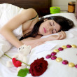 Beautiful woman sleeping with valentines gift — Stock Photo