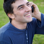 Man enjoying phone call smiling happy succes — Stock Photo
