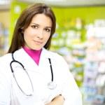 Happy pharmacist smiling at work — Stock Photo