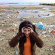 Woman shouting in front of ecologic disaster dirty beach — Stock Photo #26501231