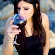 Gorgeous woman drinking red wine before dinner party — Stock Photo #28145611