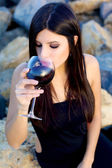 Gorgeous woman drinking red wine before dinner party — Stock Photo