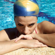 Young female swimmer thinking about competition in swimming pool for world record — Stock Photo