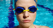 Portrait of female professional swimmer in the water — Stock Photo