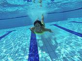 Happy smiling girl underwater — Stock Photo