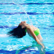 Flying long hair in swimming pool in summer — Stock Photo