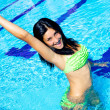 Young model having fun in swimming pool — Stock Photo