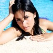Young woman thinking in swimmingpool — Stock Photo