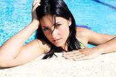 Young woman thinking in swimmingpool — Stock Photo
