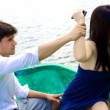 Womangry with boyfriend wanting to throw phone in water — Stock Photo #38380989