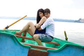Happy couple in love in vacation on little boat — Stock Photo