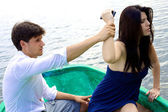Woman angry with boyfriend wanting to throw phone in water — Foto de Stock