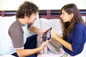 Funny couple fighting for tablet — Stock Photo