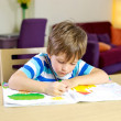 Little kid making homework writing — Stock Photo