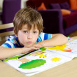 Handsome blond child good by at home drawing — Stock Photo #41295095