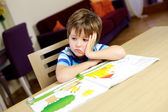 Bored little child student at home — Stock Photo
