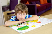 Handsome blond child good by at home drawing — Stock Photo