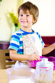 Happy smiling kid cooking at home — Stock Photo