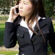 Chinese business woman listening to phone call serious — Stock Photo #43261747