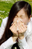 Portrait of sic chinese woman sneezing because of allergy and flu — Stock Photo