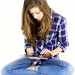 Female teenager having a good time with digital tablet isolated — Stock Photo