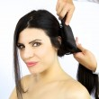 Beautiful woman getting hair brushed by stylist — Stock Photo #44690221