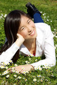 Happy cute asian woman relaxing in spring — Stock Photo