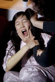 Domestic violence asian woman hit by husband at home — Stock Photo