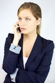 Serious gorgeous blond business woman on the phone — Stock Photo
