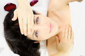 Happy beautiful woman laying in spa  — Stock Photo