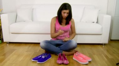 Girl deciding the shoes to put on — Stock Video