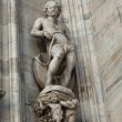 Stock Photo: Statue of mwall of duomo Cathedral in milano