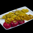 Stock Photo: Mixed pepper pickles on white plate