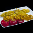Mixed pepper pickles on the white plate — Stock Photo