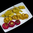 Mixed pepper pickles on the white plate at Top view — Stock Photo