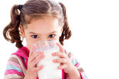 Child drinking milk — Stock Photo