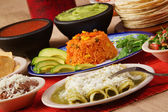 Traditional mexican green enchilada dinner — Stock Photo