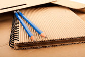 Notepad, pencils and paper folder — Stock Photo