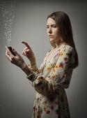 Girl with telephone — Stock Photo